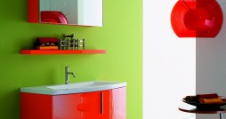 Green-bathroom-with-red-modern-vanity-and-mirror