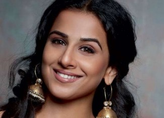 bollywood actress vidya balan in heavy gold jhumkas