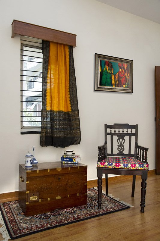 antique dark rosewood chair with phulkari cushion