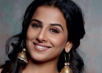 bollywood actress vidya balan in heavy gold jhumkas